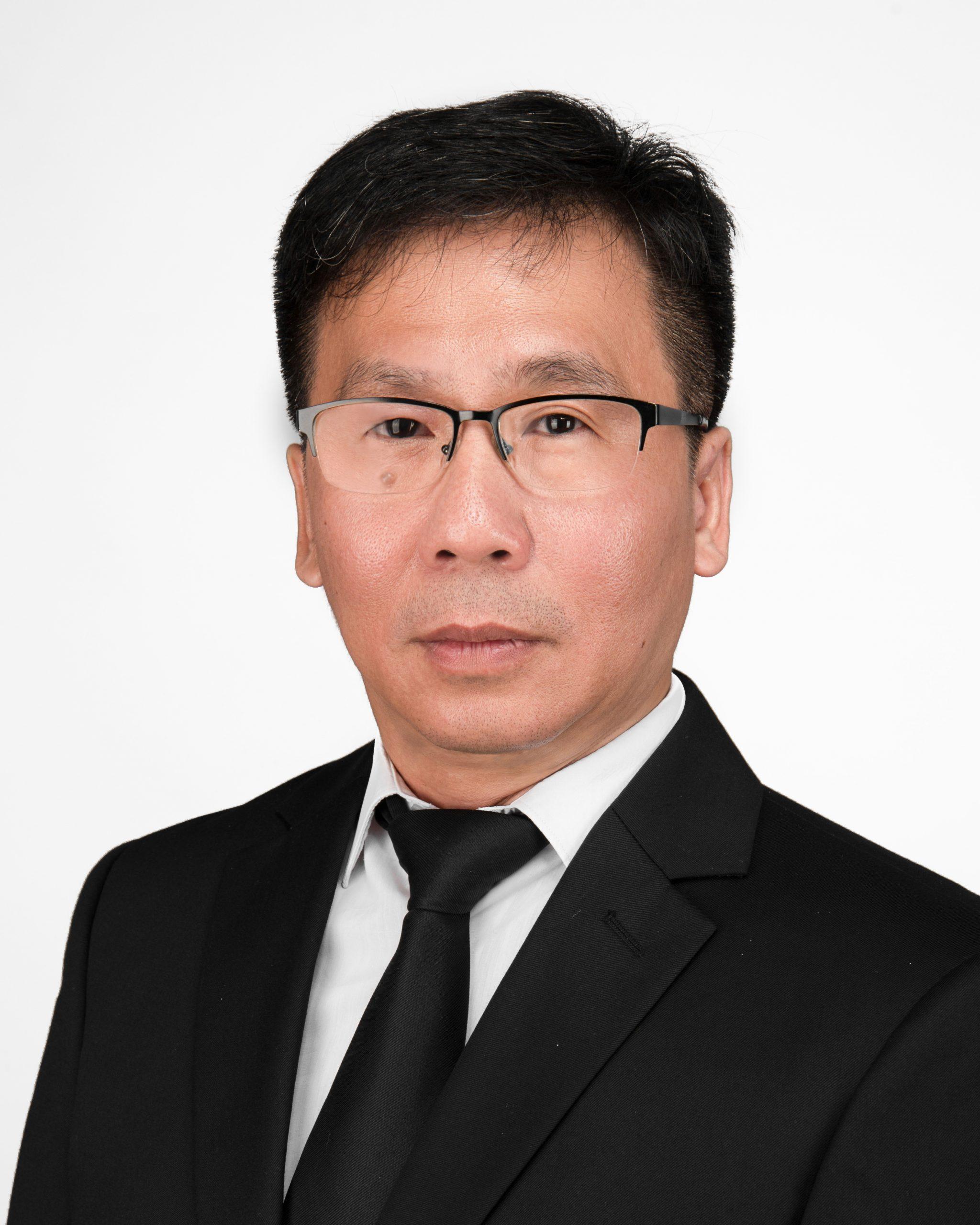 譚建業教授